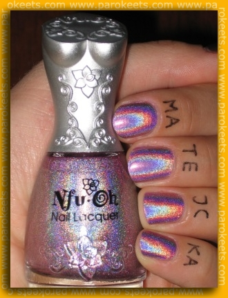 My favorite nail polish and the front of the bottle. Isn't this rainbow just gorgeous? Photo was taken indoors under artificial light with flash.
