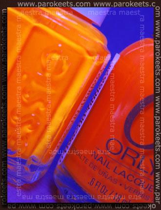 Under blacklight: Orly - Orange Punch vs. Essie - Bright Tights