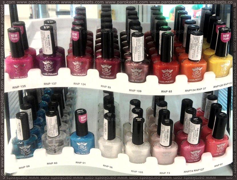 Ruby Kisses nail polish stand by Parokeets