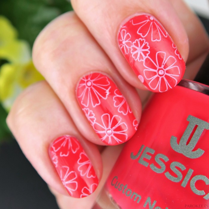 White flowers on coral pink nails (Jessica Runway Ready)